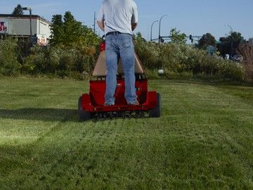 Stand-on aerator