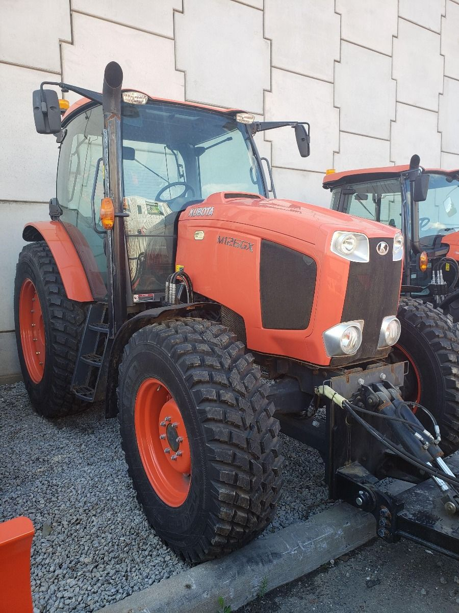 Kubota M126 Tractor with Wing Blade