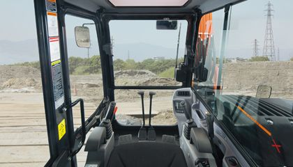 Deluxe interior - A spacious cab, full suspension seat, and new digital panel bring comfort to any job.
