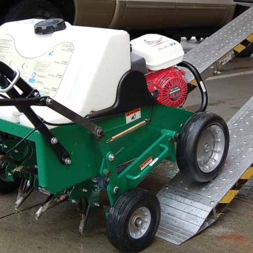 Outboard drive wheels - Eliminate both center wheel slip and abuse from ramp loading with the tines engaged.
