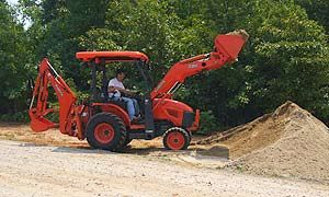 The B26's Mechanical Spill Guard tilts the bucket forward as the loader is raised