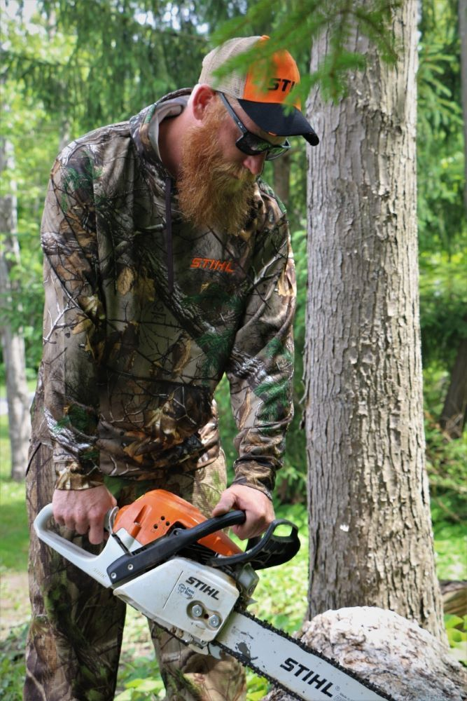 STIHL camouflage hooded sweater. Model is 6'1 and wearing size XL.