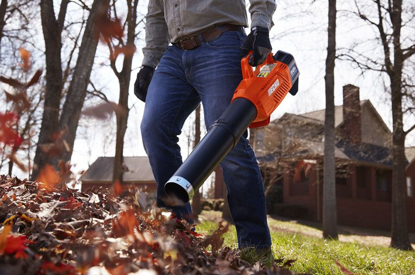 ECHO 58V Handheld Blower with 2AH Battery & Charger In Action