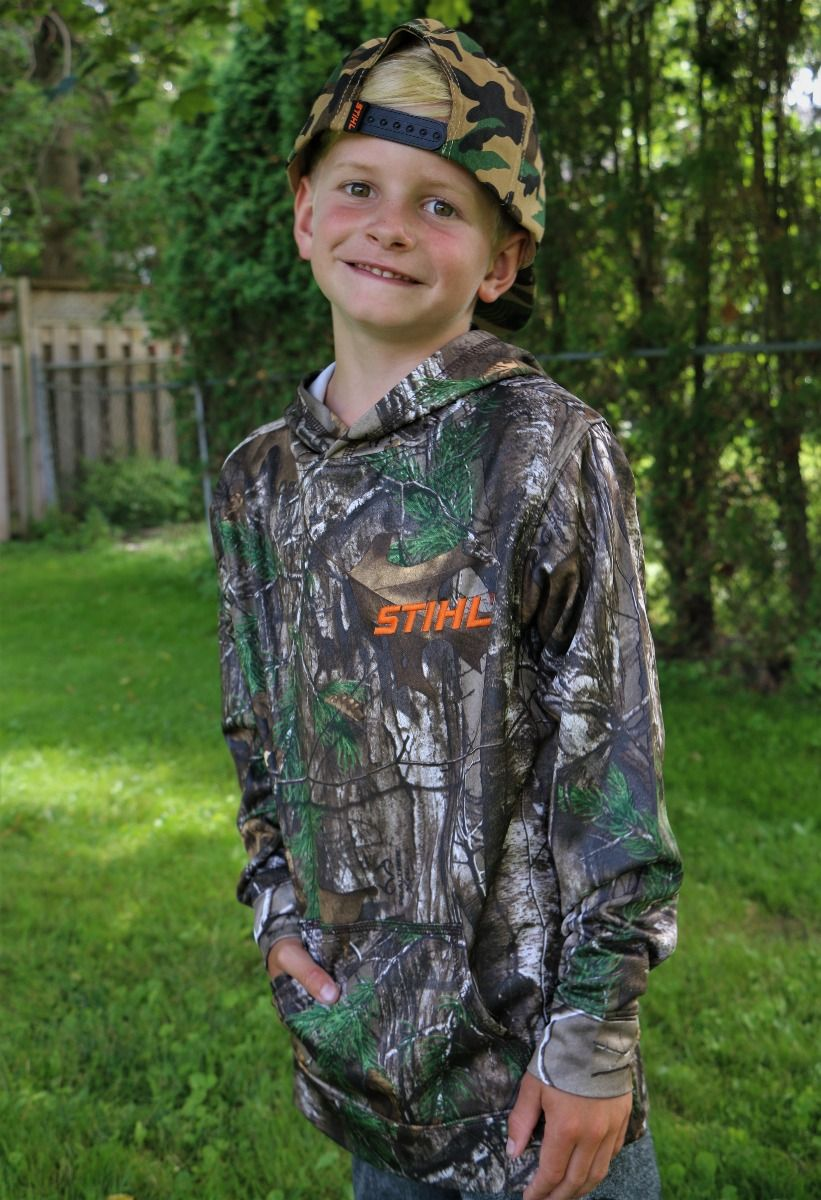 STIHL camo sweater Model is 6 years old - wearing size small