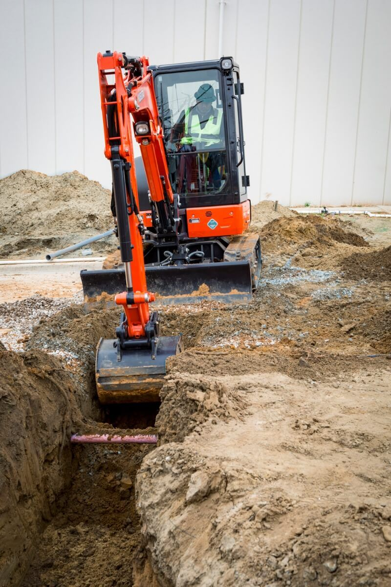 Kubota KX033-4 Mini Excavator in action