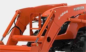 The front loader features a rounded boom that matches the hood, for a sleek look and increased visibility during loader operations.