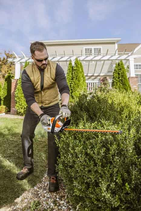 The HSA 45 STIHL handheld Battery Hedge Trimmer in action