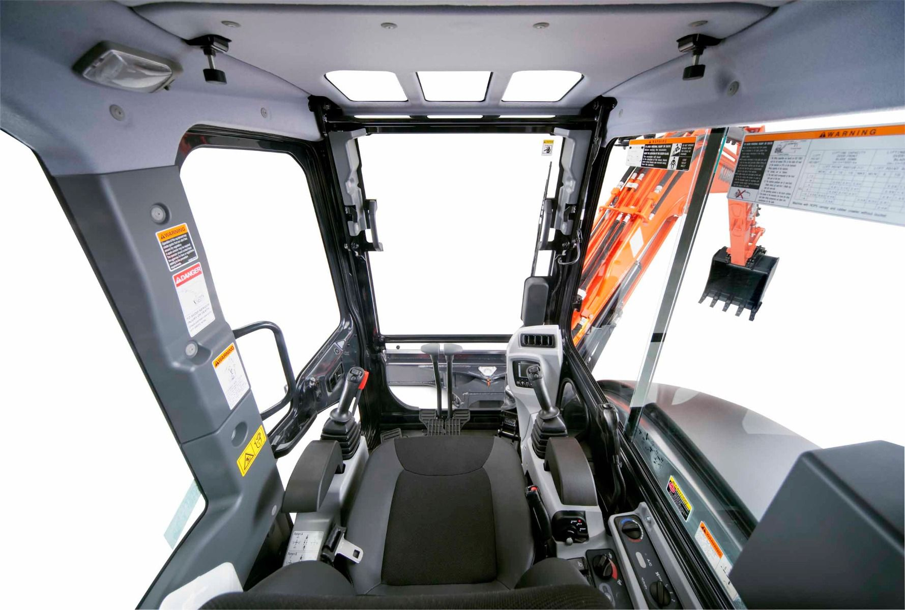 The deluxe cab features improved climate control and air flow, wider entrance, suspension seat,and repositioned instrument panel.