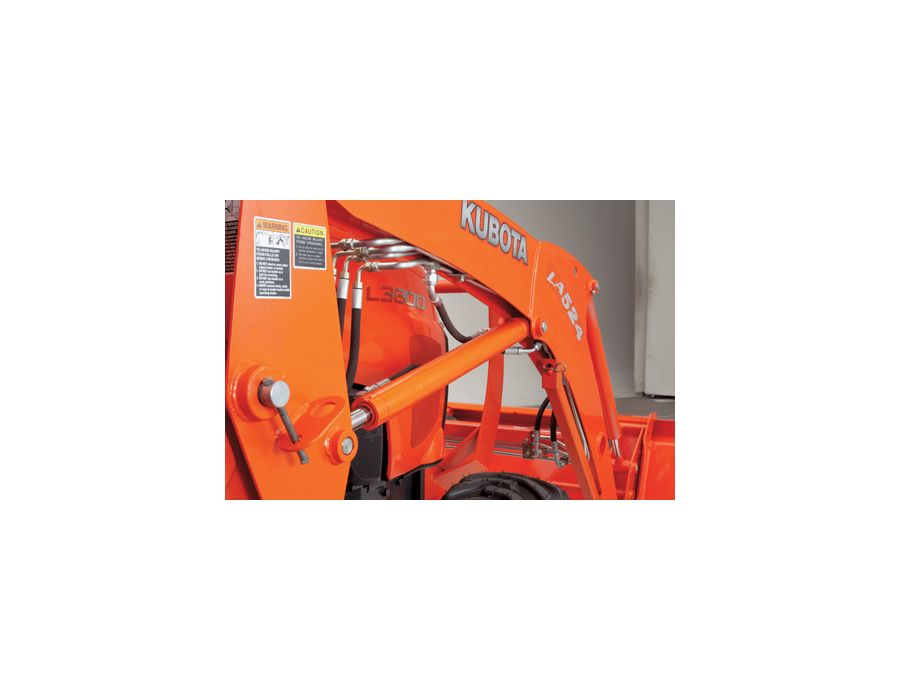 The front loader's thick single piece steel frames provide better durability as well as creating a better view between the tractor and the boom.