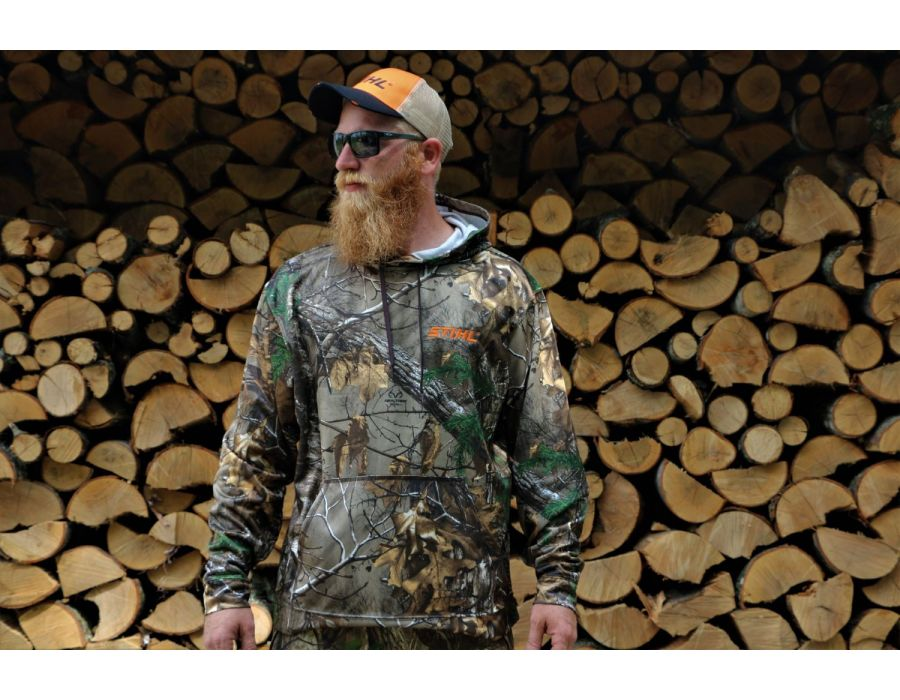 """RealTree Camouflage Hoodie with STIHL embroidered logo. Model is 6'1"""" wearing size XL"""