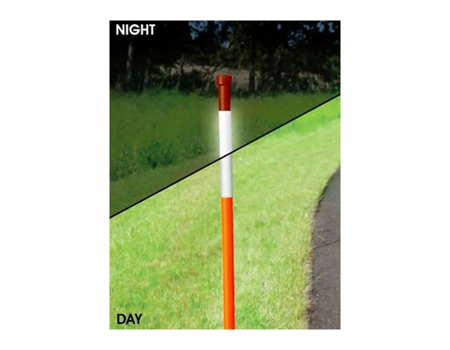 Reflective orange driveway marker shown at night and during the day