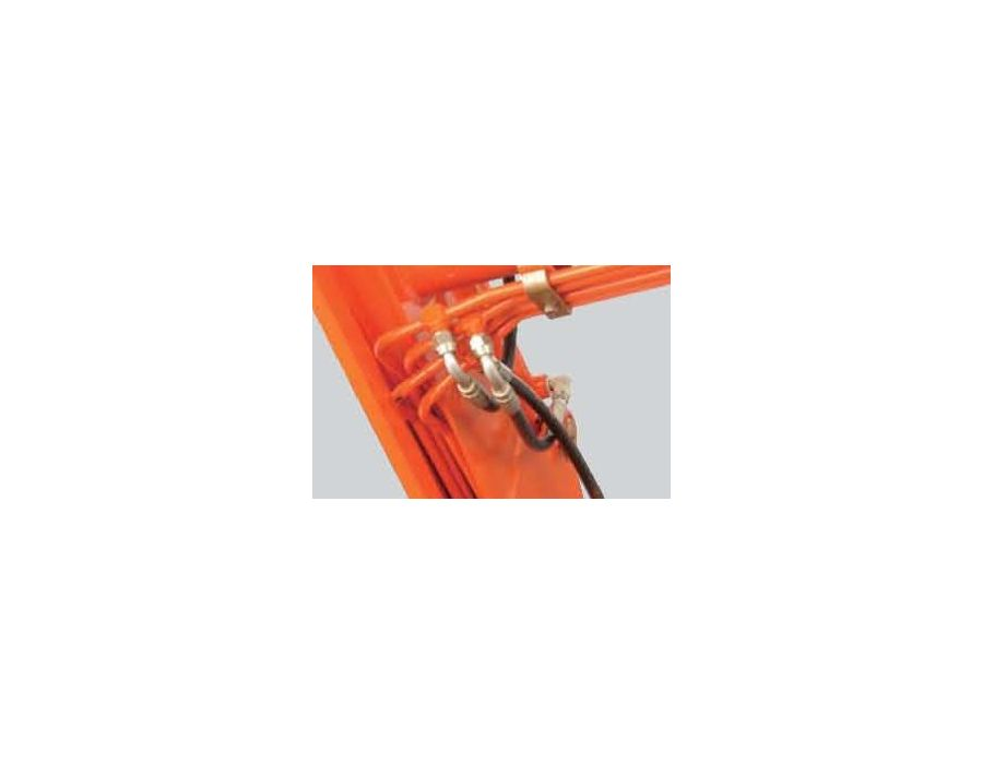 The hydraulic hoses are routed through a recessed area under the loader lift arm for increased protection, longer life, improved visibility, and a cleaner-looking design.