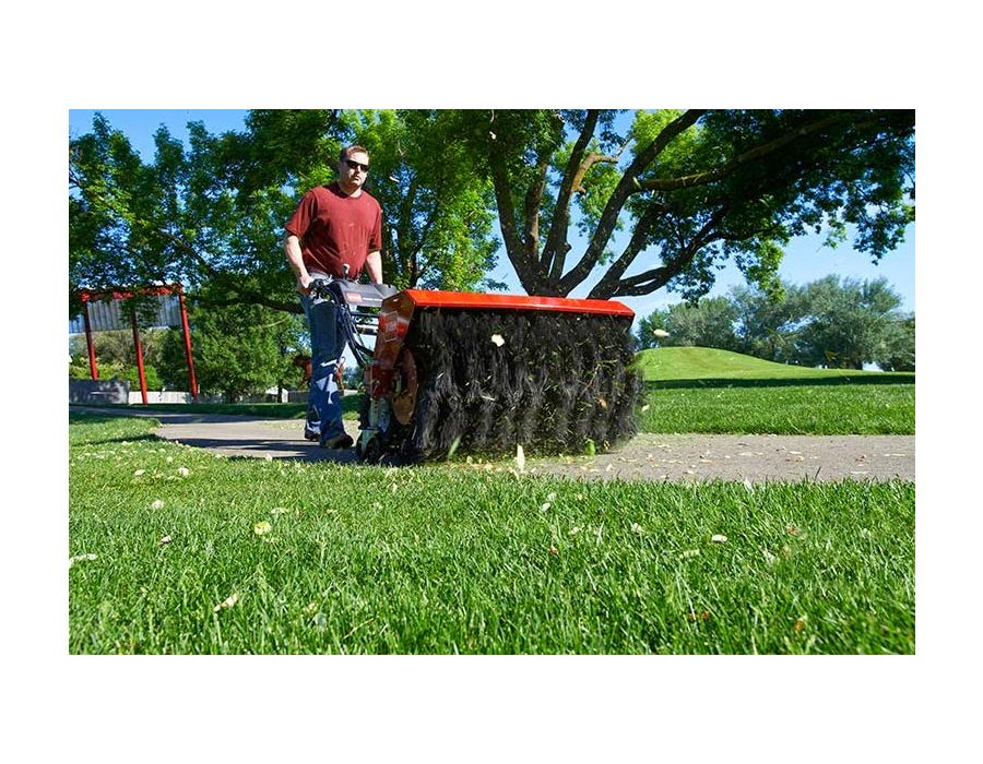 Toro Power Broom easily brushes away grass clippings and debris