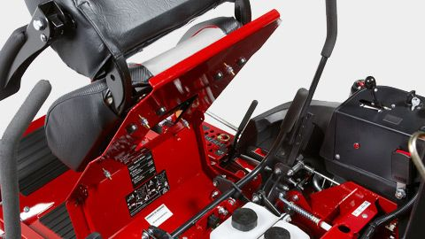 Flip-up seat provides easy access to serviceable components. Belt and blade part numbers are referenced under seat.