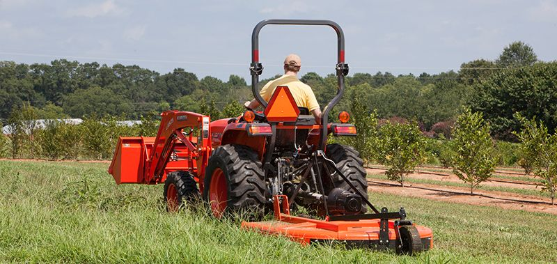 Kubota L2501HST tractor with mowing attachment