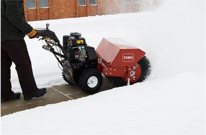 Toro Power Broom side shot of snow removal process.